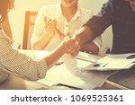 business handshaking process... | Shutterstock . vector #1069525361