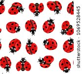 ladybug seamless pattern ... | Shutterstock .eps vector #1069528445