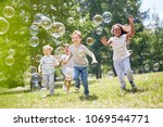 multi ethnic group of little... | Shutterstock . vector #1069544771