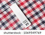 white textile xs clothes label... | Shutterstock . vector #1069549769