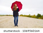Girl in black coat with red...