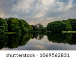 blue sky over a lake and green... | Shutterstock . vector #1069562831