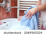 hand drying with towel in... | Shutterstock . vector #1069565324