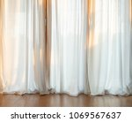 door curtain with sunlight in... | Shutterstock . vector #1069567637
