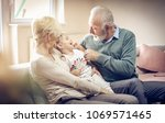 grandparents playing at home...   Shutterstock . vector #1069571465