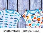 newborn kids clothes hanging on ... | Shutterstock . vector #1069573661