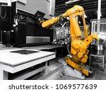 robot arm bending metal sheet... | Shutterstock . vector #1069577639