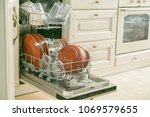 dishwasher full with clean... | Shutterstock . vector #1069579655