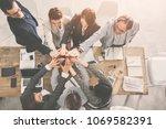 business team is giving high... | Shutterstock . vector #1069582391