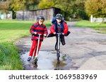 two little kids boys riding on... | Shutterstock . vector #1069583969