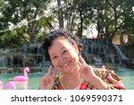 asian senior woman | Shutterstock . vector #1069590371