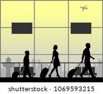 the luggage family rushes to... | Shutterstock .eps vector #1069593215