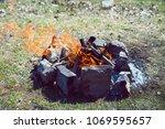 bonfire in nature. camping | Shutterstock . vector #1069595657