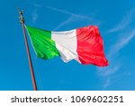 flag of italy against the blue... | Shutterstock . vector #1069602251