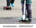 children riding a scooter  feet ... | Shutterstock . vector #1069635167