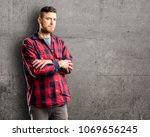 young handsome man nervous and... | Shutterstock . vector #1069656245