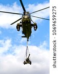Small photo of Yeovilton, Somerset, UK - July 6, 2007: A Royal Navy Westland Sea King HC.4 helicopter with an underslung load of a 105mm light gun