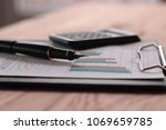 close up. gold tipped pen and... | Shutterstock . vector #1069659785