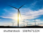 white wind turbine silhouette...   Shutterstock . vector #1069671224