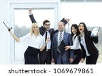 happy business team raising... | Shutterstock . vector #1069679861