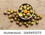 ceylon oak on wooden table... | Shutterstock . vector #1069692575