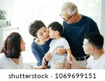 boy kissing grandmother on... | Shutterstock . vector #1069699151