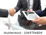 two confident businessmen... | Shutterstock . vector #1069706804