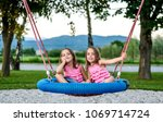 identical twin girls on spider... | Shutterstock . vector #1069714724