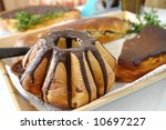Easter cake with chocolate glazing and other home-baked pies - stock photo