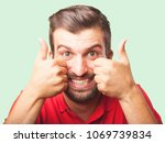 young handsome man  okay or all ... | Shutterstock . vector #1069739834