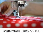 female hands on sewing machine. ... | Shutterstock . vector #1069778111
