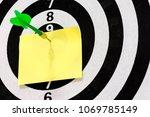 note paper with steel tip darts ... | Shutterstock . vector #1069785149