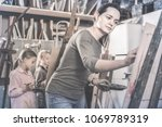 skillful young cheerful... | Shutterstock . vector #1069789319