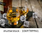 whiskey on rustic wood... | Shutterstock . vector #1069789961