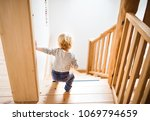 toddler boy in dangerous... | Shutterstock . vector #1069794659