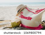 sandy beach with beach bag and... | Shutterstock . vector #1069800794