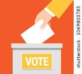 vote. hand putting paper in...   Shutterstock .eps vector #1069803785