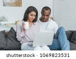 african american couple using... | Shutterstock . vector #1069823531