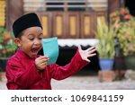 a malay boy in malay... | Shutterstock . vector #1069841159