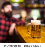 glass with beer on bar counter  ...   Shutterstock . vector #1069843337