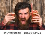 barman with beard and angry... | Shutterstock . vector #1069843421