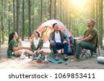 asian couple camping in their... | Shutterstock . vector #1069853411
