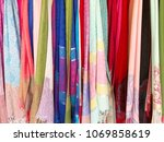 colorful scarves at a market in ... | Shutterstock . vector #1069858619