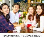 group of four happy asian young ... | Shutterstock . vector #1069865039