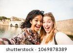 happy multiracial girlfriends...   Shutterstock . vector #1069878389