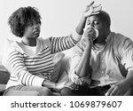 man sneezing into tissue paper   Shutterstock . vector #1069879607