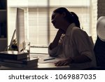 asian women aches from working... | Shutterstock . vector #1069887035