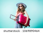 smiling young tourist woman... | Shutterstock . vector #1069890464