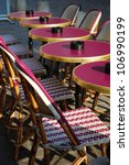 Typical outdoor cafe with tables and chairs on the sidewalk in Paris, France - stock photo