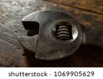 Small photo of Patina Rich Old Spanner head on dark Wooden background